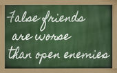 Expression - False friends are worse than open enemies - written — Photo