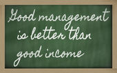 Expression - Good management is better than good income - writt — Zdjęcie stockowe