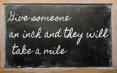 Expression - Give someone an inch and they will take a mile - w — 图库照片