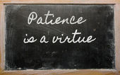 Expression - Patience is a virtue - written on a school blackbo — Stock Photo
