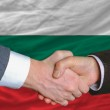 Businessmen handshake after good deal in front of bulgaria flag — Stock Photo