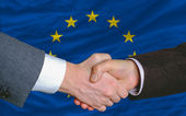 Businessmen handshake after good deal in front of europe flag — Stock Photo