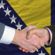 Businessmen handshake after good deal in front of bosnia herzego — Stock Photo #8051821