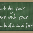 """ Don't dig your grave with your own knife and fork "" writte — Stock Photo #8052958"