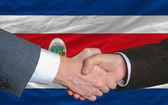 Businessmen handshakeafter good deal in front of costarica flag — Stock Photo