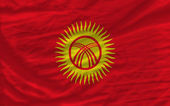 Complete waved national flag of kirghizstan for background — Stock Photo