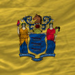 Постер, плакат: Complete waved flag of american state of new jersey for backgrou