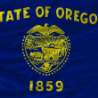Постер, плакат: Complete waved flag of american state of oregon for background