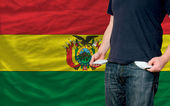 Recession impact on young man and society in bolivia — Stock Photo
