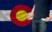 Recession impact on young man and society in colorado — Stock Photo