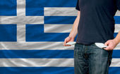 Recession impact on young man and society in greece — Stock Photo