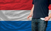 Recession impact on young man and society in holland — Stock Photo