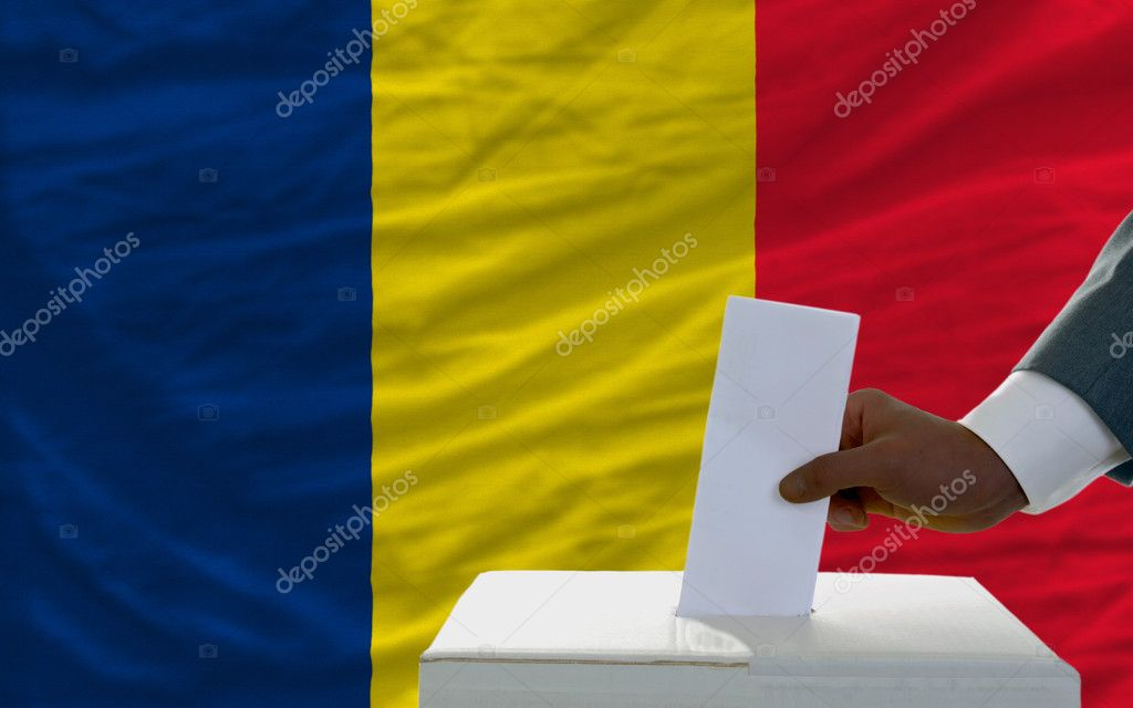 Man putting ballot in a box during elections  in front of national flag of chad — Stock Photo #8633209