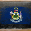Flag of US state of maine on blackboard painted with chalk - Stock Photo