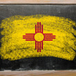 Stock Photo: Flag of US state of new mexico on blackboard painted with chalk