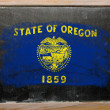 Royalty-Free Stock Photo: Flag of US state of oregon on blackboard painted with chalk