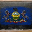 Flag of US state of pennsylvania on blackboard painted with chal — Stock Photo