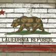 Grunge flag of US state of california on brick wall painted with — Foto de Stock