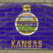 Grunge flag of US state of kansas on brick wall painted with cha — Stock Photo