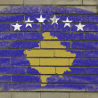 Grunge flag of kosovo on brick wall painted with chalk — Foto de Stock