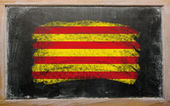 Flag of catalonia on blackboard painted with chalk — Stock Photo
