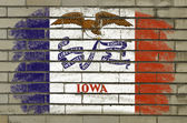 Grunge flag of US state of iowa on brick wall painted with chalk — Stock Photo