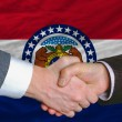 In front of american state flag of missouri two businessmen hand — Stock Photo