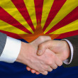 Stock Photo: In front of americstate flag of arizontwo businessmen hands