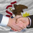 Stock Photo: In front of americstate flag of illinois two businessmen hand