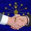 Stock Photo: In front of americstate flag of indiantwo businessmen hands