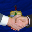 In front of american state flag of vermont two businessmen hands — Stock Photo #8742581