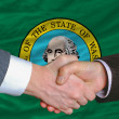 In front of american state flag of west washington two businessm — Stockfoto
