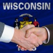 Stock Photo: In front of americstate flag of west wisconsin two businessme