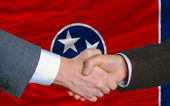 In front of american state flag of tennessee two businessmen han — Stock Photo