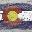 Flag of US state of colorado on grunge wooden texture precise pa — Stock Photo