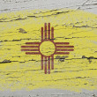 Stock Photo: Flag of US state of new mexico on grunge wooden texture precise