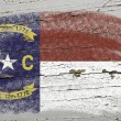 Flag of US state of north carolina on grunge wooden texture prec — Stock Photo #8777901
