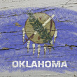 Flag of US state of oklahoma on grunge wooden texture precise pa — Photo
