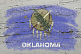 Flag of US state of oklahoma on grunge wooden texture precise pa — Stock Photo