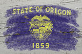Flag of US state of oregon on grunge wooden texture precise pain — Stock Photo