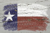 Flag of US state of texas on grunge wooden texture precise paint — Stock Photo