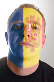 Face of serious patriot man painted in colors of andorra flag — Stock Photo