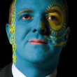 Face of serious businessman or politician painted in colors of k — Stock Photo #8802305
