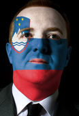Face of serious businessman or politician painted in colors of s — Stock Photo