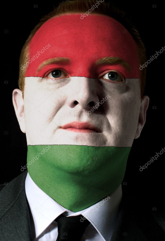 High key portrait of a serious businessman or politician whose face is painted in national colors of hungary flag — Stock Photo #8802191