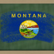Flag of us state of montana on blackboard painted with chalk - Stock Photo