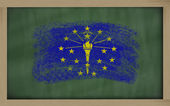 Flag of us state of indiana on blackboard painted with chalk — Stock Photo