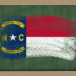 Flag of us state of north carolina on blackboard painted with ch - Stock Photo