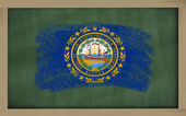 Flag of us state of new hampshire on blackboard painted with cha — Stock Photo