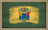 Flag of us state of new jersey on blackboard painted with chalk — Stock Photo